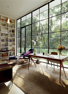 Glass House, East Hampton  Photo: Billy Cunningham Jean Prouve Compass Desk (1953), Eero Saarinen Womb Chair for Knoll (1946), Jacques Adnet desk (50s), custom steel windows and doors.