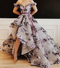 Floral Purple Gown by Dona Matoshi. Shop for beautiful Gowns at Dona Matoshi. Discover a fabulous selection of dresses. Pretty Prom Dresses, High Low Prom Dresses, Long Prom Gowns, Ball Dresses, Elegant Dresses, Homecoming Dresses, Nice Dresses, Evening Dresses, Elegant Ball Gowns