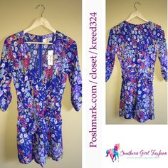 "YUMI KIM Romper Floral Printed Belted Waist Jumper Size Small.  New With Tags $228.00  Crossover v neck romper with 3/4 tabbed sleeves. Shorts are lined.  100% Polyester.  Measurements (garment flat) : Length: 30.5"" Underarm to Underarm: 17"" Belted Waist: 14.8"" Inseam: 3.5""  Availability:  Blue: XS, S, M. Pink: XS, L.    ❗️ Please - no trades, PP, holds, or Modeling.   ✔️ Reasonable offers considered when submitted using the blue ""offer"" button.    Bundle 2+ items for a 20% discount!    Stop…"
