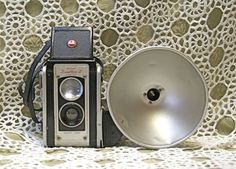 vintage kodak camera - I remember those square plastic flashbulbs you had to insert in that metal thing! :)
