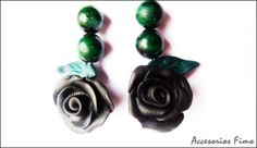 http://www.artesanum.com/artesania-pendientes_rosas_rojas_con_hoja-230137.html