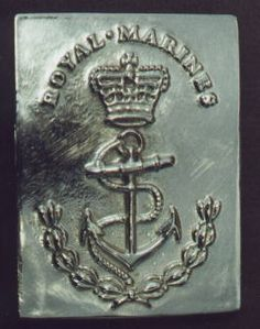 Royal Marine's brass crossbelt plate. This was used both for decorative purposes and to join the two ends of the bayonet belt together. The cartouche belt would pass between the plate and the ends of the bayonet belt, and so the plate effectively kept the two crossbelts together, joining them where they crossed. British Royal Marines, British Royals, Royal Marines Uniform, American Revolution, French Revolution, Military Belt, Falklands War, War Of 1812, War Photography