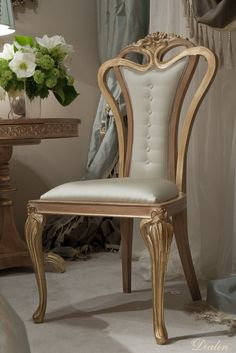 gold chair with champagne upholstery