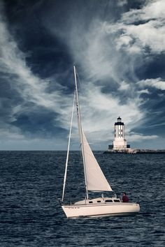 Sailboat and Angel's Gate Lighthouse -  Los Angeles Harbor, California.