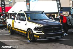 "Pfaff Designs debuted their new ""Draggin Wagon"" shop truck, at the 2015 SEMA Show. This Dodge Ram 1500 2wd is powered by a Magnuson Superchargers 5.7L HEMI and rides on Belltech Sport Trucks suspension (with a 4-inch drop) and Toyo Tires on staggered 20/22-inch Forgeline GA3C Concave wheels. See more at: http://www.forgeline.com/customer_gallery_view.php?cvk=1507  ‪#‎Forgeline‬ ‪#‎GA3C‬ ‪#‎notjustanotherprettywheel‬ ‪#‎madeinUSA‬ ‪#‎Dodge‬ ‪#‎Ram1500‬ ‪#‎SEMA2015‬"