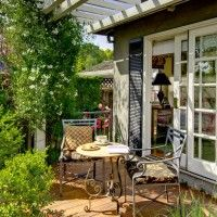 Magnificent French Maid decorating ideas for Delightful Patio Traditional design ideas with deck furniture flowers outdoor dining pergola plants relaxing sliding glass doors
