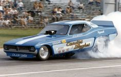 """Leroy Goldstein,laying down rubber in the """"Candies & Hughes"""" '72 Cuda F/C."""