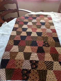 Tumbler quilt in Fall colors. I want to do one of these with the homespun fabrics I have and use old feed sacks for the backing. Tumbling Blocks Quilt, Quilt Blocks, Tumbler Quilt, Primitive Quilts, Country Quilts, Fall Quilts, Miniature Quilts, Quilted Table Runners, Quilt Bedding
