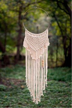 This Macramé Wall Hanging is sure to add a modern, beautiful, cozy focal point to any room or space! Made of all natural cotton cord, a metal hoop and wood beads for a perfect blending of natural elements. The beads on this piece can be customized to a darker wood color, please reach out
