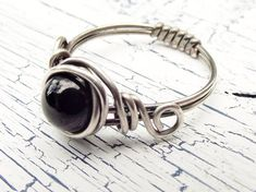 Hey, I found this really awesome Etsy listing at http://www.etsy.com/listing/100007277/black-onyx-sterling-silver-ring-wire