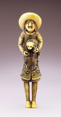 Japan  Dutchman Holding Dog, 18th century  Netsuke, Ivory with staining, sumi, inlays