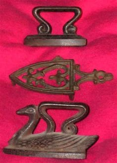 """1872 Toy sad irons, cast in iron by Stevens & Brown in Cromwell, Conn., USA; the top iron, belonging to the stand (3¾"""" long) in the middle, likely is also from their factory, although not shown in the catalogue; the duck iron is 3¼"""" long"""