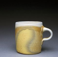 Title: Mug Artist: Louis Reilly Date: 2013 Technique: wheel thrown Temperature: Cone 11 Glazing / Surface Treatment: Soda fired, no applied slip or galze Material: High alumina stoneware with wollastonite