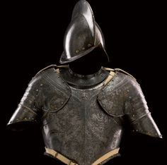 A rare north Italian half armour, late 16th century, for use by the Swiss Papal guard.