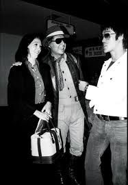 Bruce Lee with screenwriter Stirling Silliphant and his wife.