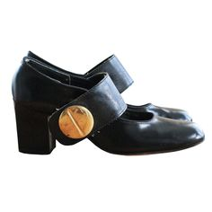 60's Vintage Black Ultra Mod Large Button Strap Leather High Heel Shoes. $30.00, via Etsy.