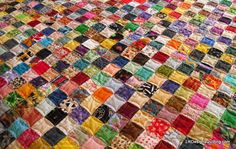 postage stamp quilts | 3584 Charms Later – Postage Stamp Quilt is done!