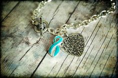 PCOS and having a baby facts.  http://pcos-and-pregnancy.com/ PCOS Teal Awareness Bracelet 003