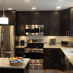 Kitchen Colors With Brown Cabinets dark cabinets, grey countertops and light wood floors | for the