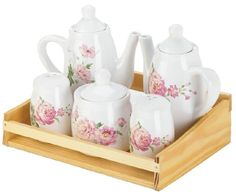 Bring the sweetness of a rose garden into your home with this charming tea set. The fir wood container holds a five-piece dolomite tea set, and each piece features pretty pink roses in bloom. It looks