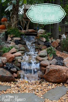 The Husband put in a pondless waterfall as part of our big backyard makeover! Today, I& giving you a peek at the waterfall and the backyard project! Backyard Water Feature, Large Backyard, Ponds Backyard, Backyard Waterfalls, Garden Ponds, Koi Ponds, Herb Garden, Diy Pondless Waterfall, Garden Waterfall
