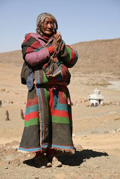 A prostrating older woman.Tibet