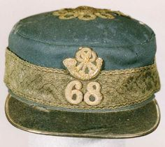Officer's Undress Forage Cap, 68th Light Infantry, 1860s. This forage cap is made from dark blue cloth with a gilt band and black leather pe...