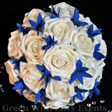 Ivory and Royal Blue Bouquet. This would be cute with silver beads and accents in it.