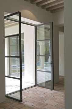 crittal style double doors also brick/terracotta floor Murphy Mears Architects Metal Building Homes, Building A House, Pole Barn House Plans, Barn Plans, Steel Doors And Windows, Garage Apartment Plans, Log Home Plans, Iron Doors, Metal Doors