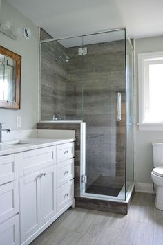 Master bathroom with wood look tile shower