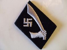 """The emblem of the 13th Waffen Mountain Division of the SS """"Handschar"""" (1st Croatian), a mountain infantry division of mostly Bosnian Muslims, featured a curved sword. The name handschar (Bosnian handžar) was actually derived from Arabic khanjar, the famously curved dagger. Curved Swords, Mounted Archery, Ottoman Turks, Types Of Swords, Horsemen Of The Apocalypse, Sword Design, National Flag, North Africa, Division"""
