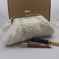 Cream Baguette Style Clutch Purse. Fabric for this purse was made by hand spinning & weaving merino and embroidery threads. The length felted to give a unique length of fabric. Kisslock metal purse frame.