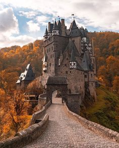 Eltz Castle (German: Burg Eltz) is a medieval castle nestled in the hills above the Moselle River between Koblenz and Trier, Germany. It is still owned by a branch of the same family (the Eltz family) that lived there in the century, . Luxury Boat, Luxury Hotels, Voyager Loin, Destination Voyage, Air France, Cultural, Medieval Castle, Kirchen, Tower Bridge