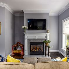 Owner's retreat with a sitting room, gas fireplace, dual walk-in closets, hardwood flooring and grey paint. Listed in Vienna, Virginia for $1.6M by The Casey Samson Team is a Wall Street Journal Top Team in Northern Virginia