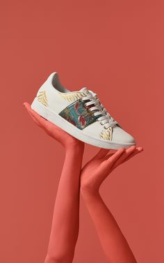 ef45f357202 These Desigual white tennis-style trainers feature a green floral side band  embroidered with golden