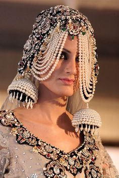 A creation by Pakistani fashion designer Anee Khoja shown during a fashion show organized by the National Fashion & Arts Council Tourism Corporation in Peshawar, Pakistan. Fashion Art, Fashion Show, Fashion Design, Fashion Ideas, Indian Costumes, Indian Bridal Hairstyles, Bridal Hair Accessories, Headgear, Wearable Art