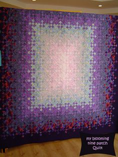My Blooming Nine Patch Quilt by Nora Shafi
