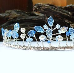 this sapphire and ice wedding tiara adds a touch of color to any white gown