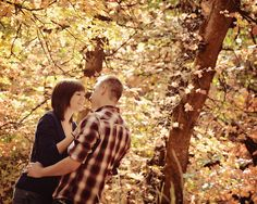 www.frostedproductions.com | #utah #photographer #engagement #photography #beautiful #fall #leaves #couple #smiling #at #eachother #autumn #colors
