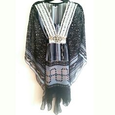 """C.O.C. 1X Black Chiffon Kimono Top This C.O.C. 1X Black Chiffon Kimono Top is in great used condition. Bejeweled front. Ties in back. 33"""" long.   100% polyester. ::: Bundle 3+ items from my closet and save 30% off when you use the app's Bundle feature! ::: No trades. C.O.C. Tops"""