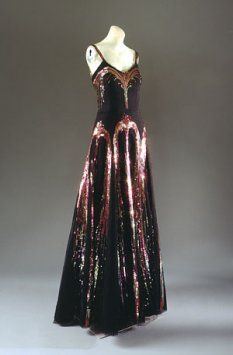 "Evening Dress,"" 1938. Gabrielle (""Coco"") Chanel. Black Silk Net with Polychrome Sequins. The Metropolitan Museum of Art, New York."