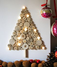 A rather quirky yet very creative Christmas tree made out of chopped wood. Shape various chopped wooden furnishings into a Christmas tree and add in light bulbs to highlight the embellishment.