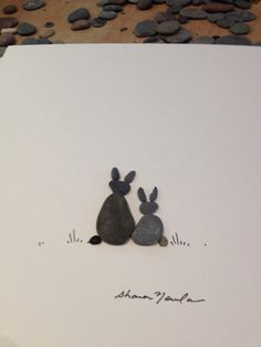 6 by 8 couple of bunnies pebble art by Sharon Nowlan by PebbleArt