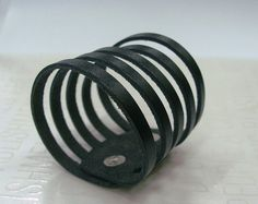 Sliced Black Leather Cuff Bracelet by Justlena on Etsy, $19.20