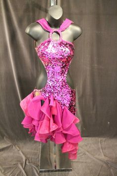 Very sexy pink latin dress for sale. Covered in sequins with large side cutouts. Halter neckline and ruffled skirt. Low, open back. Size adult small. $350 USD or best offer.