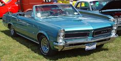 1965 Pontiac GTO - Aqua - Convertible Reno on an open highway, wind in your face and a duffle bag in the passenger seat. 1965 Gto, 1965 Pontiac Gto, Pontiac Firebird, 1957 Chevrolet, Chevrolet Chevelle, Cadillac, Auto Gif, Chevy, Gto Car