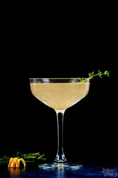 A gorgeous pink grapefruit cocktail, infused with cardamom gin, topped with a splash of prosecco and finished with a sprig of thyme.