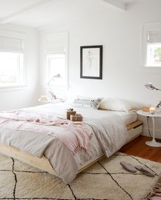 Light & airy bedroom with pastel accessories and Saarinen tulipe tables as nightstands