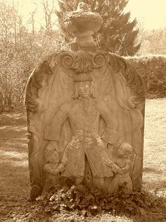 """The churchyard surrounding the Old Parish Church is home to a number of fascinating headstones, perhaps the most striking being that for John Craig, a local farmer who died in 1742. He is shown in his best clothing and with his children. """