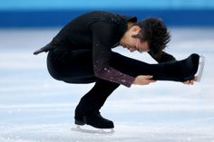 SOCHI, RUSSIA - FEBRUARY 13: Daisuke Takahashi of Japan competes during the Men's Figure Skating Short Program on day 6 of the Sochi 2014 Winter Olympics at the at Iceberg Skating Palace on February 13, 2014 in Sochi, Russia. (Photo by Matthew Stockman/Getty Images)